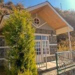A beautiful view of stone cottage at the Koti Village Resort, Koti, Himachal Pradesh