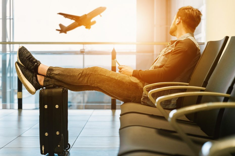 A frequent flyer waiting on an airport because of not registering to the best frequent flyer program in India.